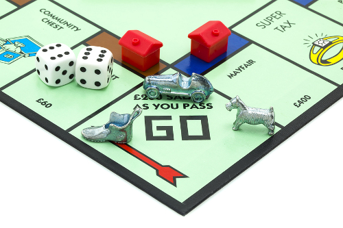 Monopoly game with houses on rental properties.