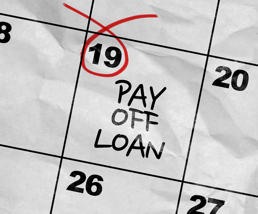 Calendar with date circled to pay off loan