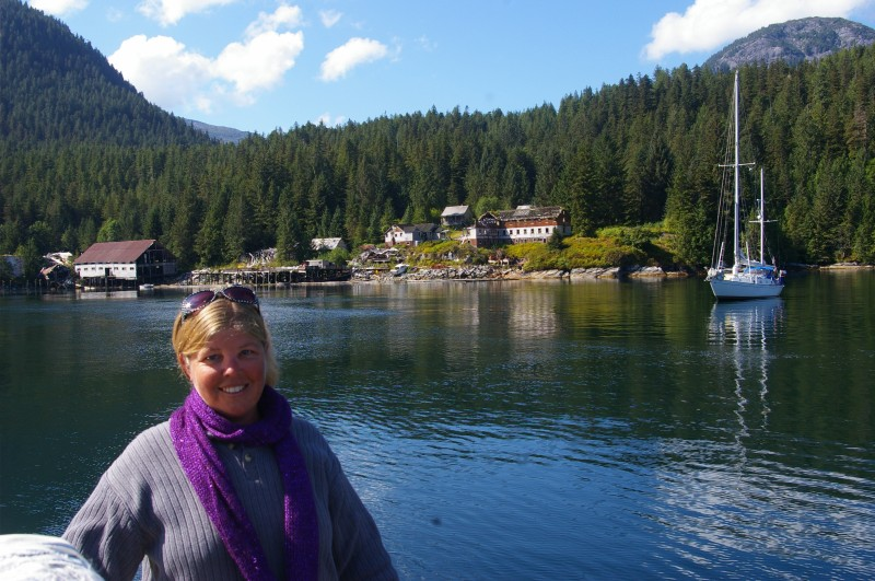 Emily Caryl Ingram on an anchored boat in a cove in British Columbia.