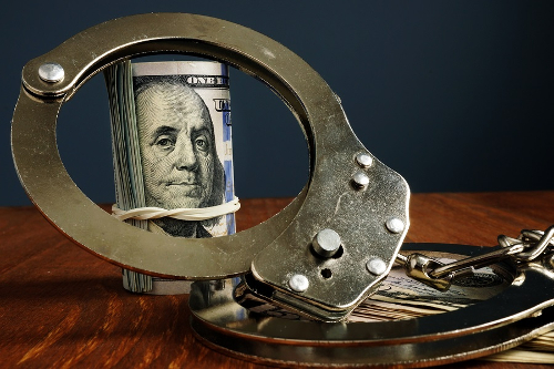 Money and Handcuffs - Prepayment Penalty